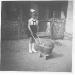 Kislány vesszőből font babakocsival 1958
